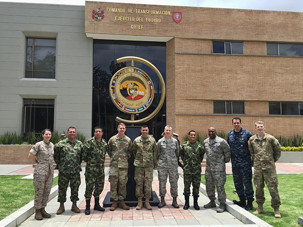 Judge advocates on the DIILS team (Maj Carina Cuellar, USMC; CPT Matt Pinckney, US Army; MAJ Norberto DaLuz, US Army; Lt Col Steve Loertscher, USAF; Maj Dan Johnson, South Carolina Air National Guard; LT Brigham Fugal, USN; CPT Tom Travers, US Army) with officers from the Colombian Ministry of Defense Human Rights Directorate during the April 2016 DIILS Operations Law Course.